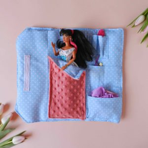 barbie-doll-with-black-hair-in-cotton-blue-sleeping-bag