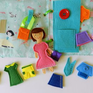felt-doll-in-pink-dress-on-the-quiet-book