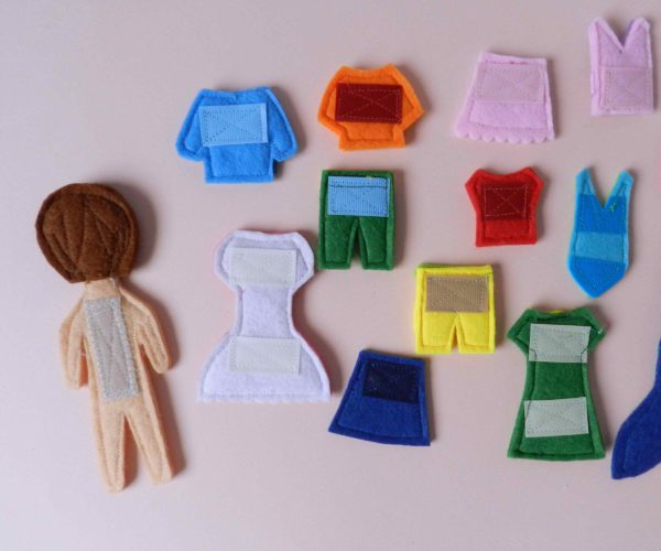 back-of-fabric-clothes-and-felt-doll-for-children